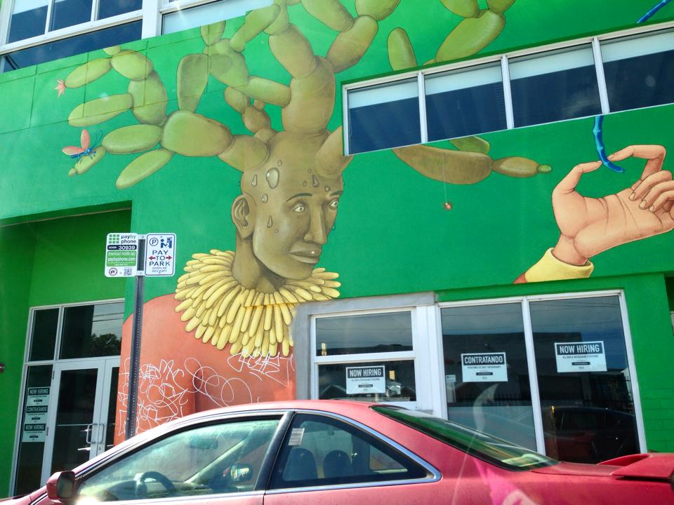 A graffiti painting of a man with a cactus growing out of his head